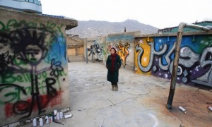 Afghan artist Shamsia Hassani poses for a photograph on the roof of her graffiti workshop in Kabul